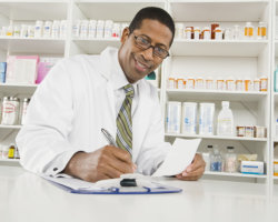 pharmacist writing on paper